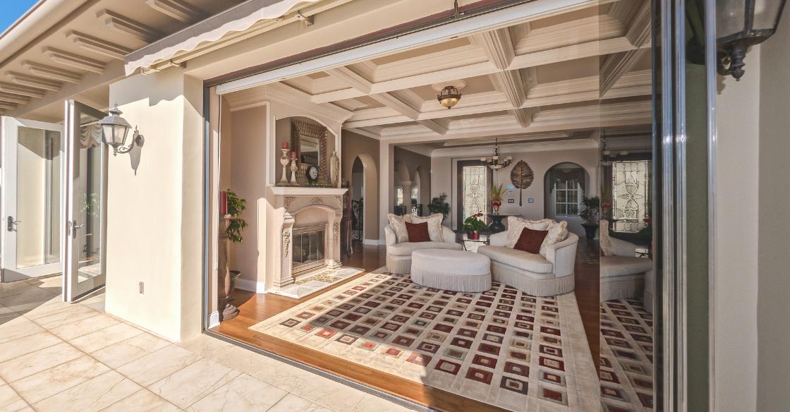 Living room with frameless glass doors