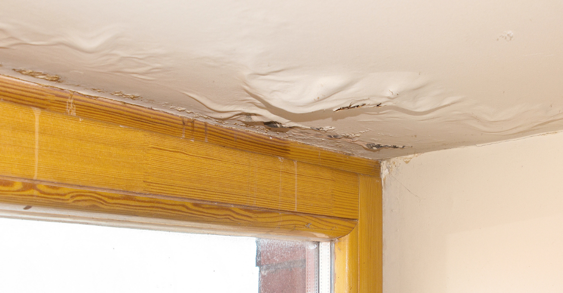 Ceiling damage in a home caused by poor water drainage