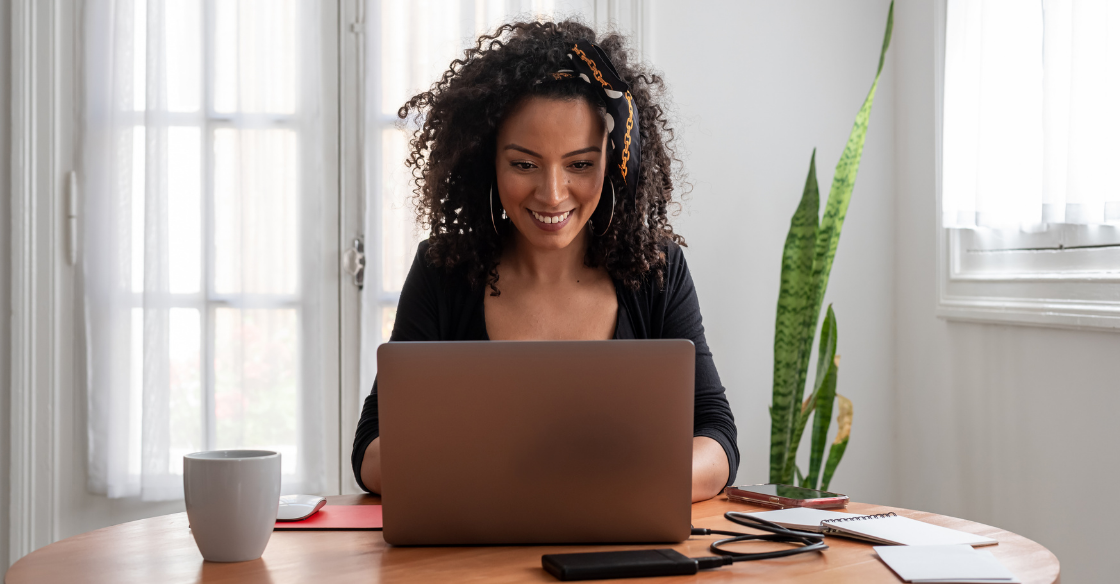 Woman working from home at her dinging table