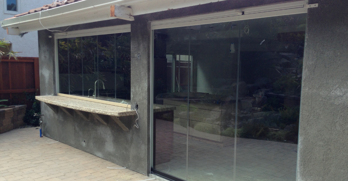 Cover Glass frameless glass window and door system installation