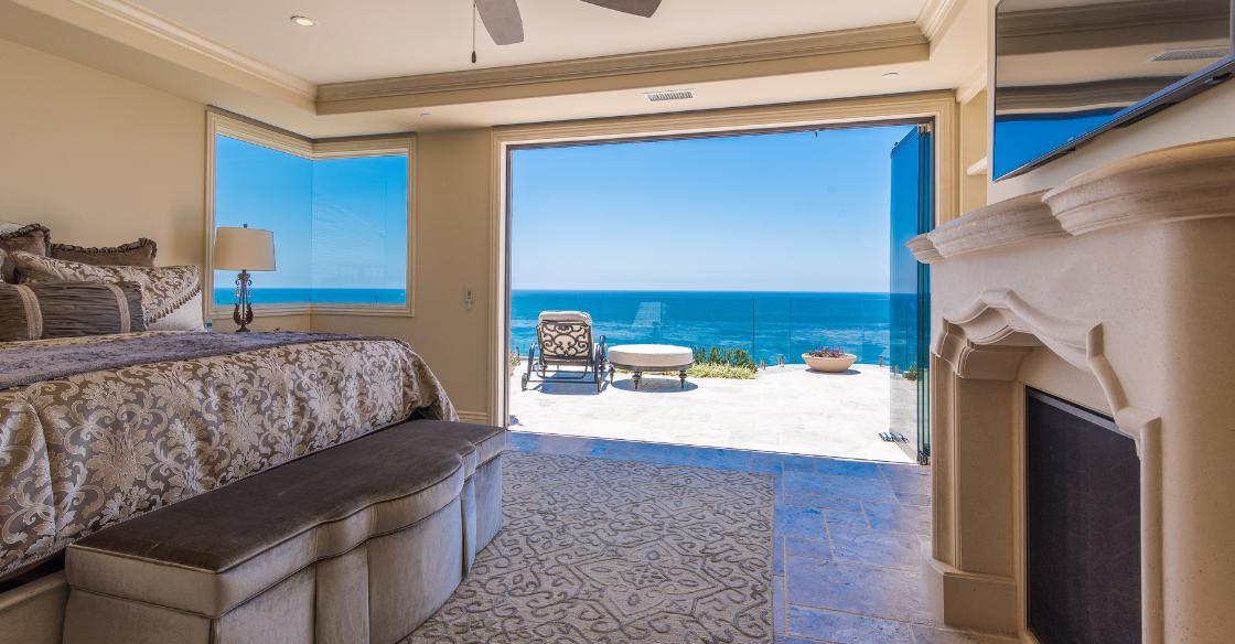 Luxurious bedroom with frameless glass doors