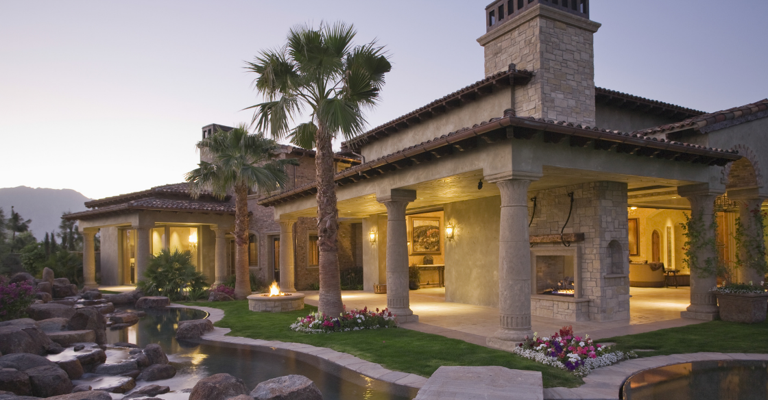 Mediterranean-style home with stone vaneer