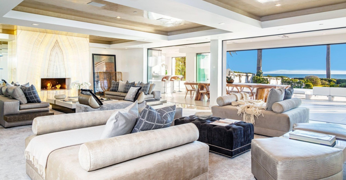 Living room with frameless glass doors fully opened