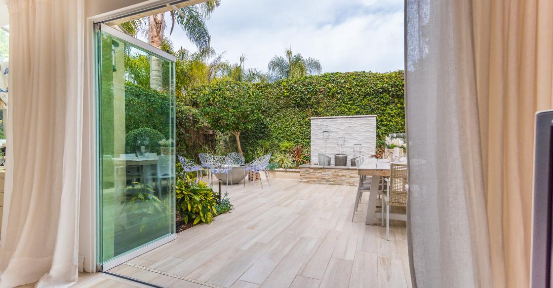 Indoor/outdoor living with frameless glass doors