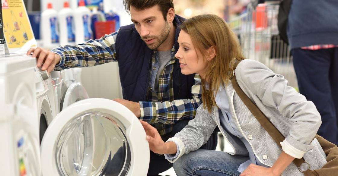 Couple looking for energy efficient appliances