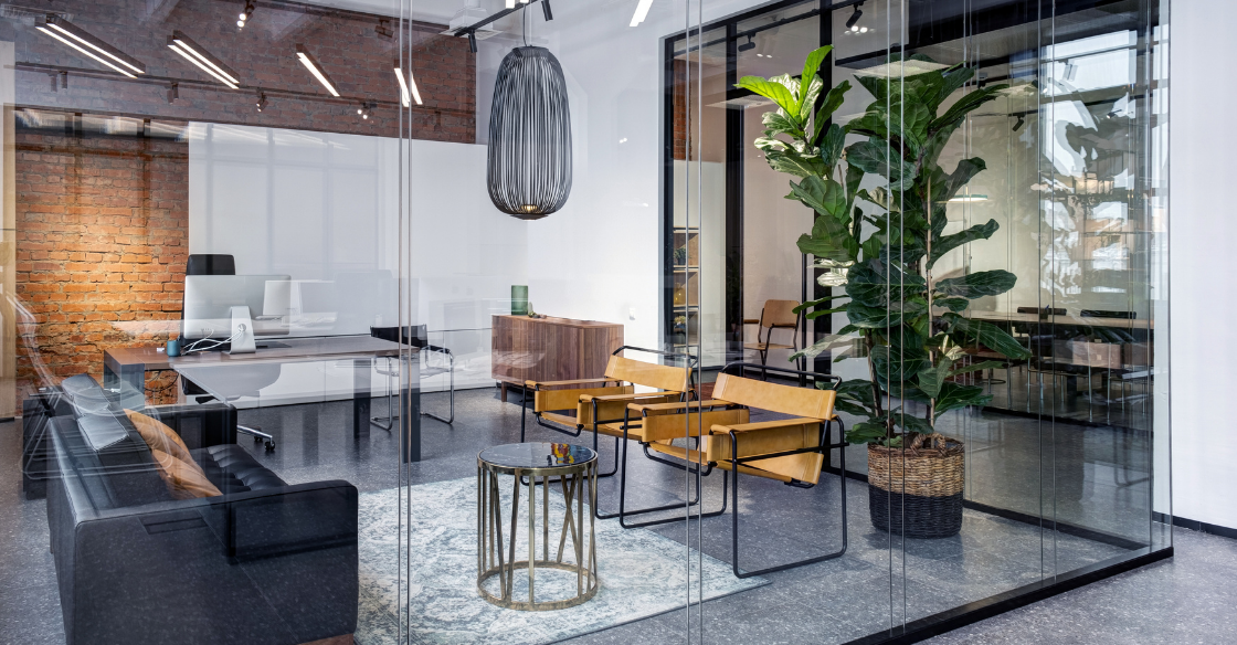 office surrounded by frameless glass walls
