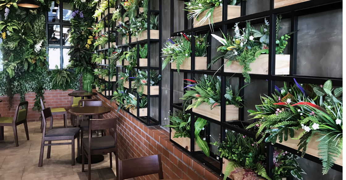 Coffee shop with a plant wall