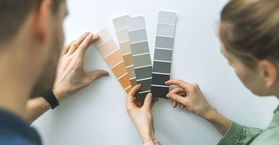 Couple selecting a paint color to update their home