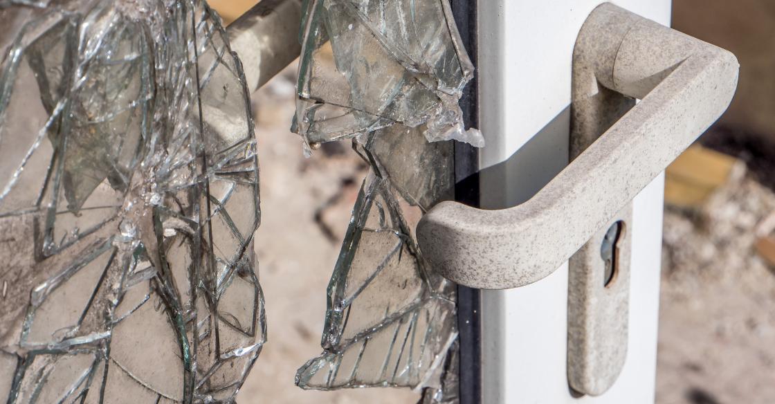 Glass door broken by an intruder