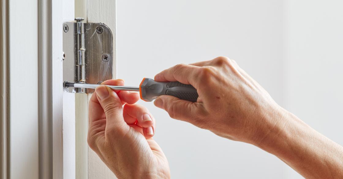 person tightening their patio door hinges
