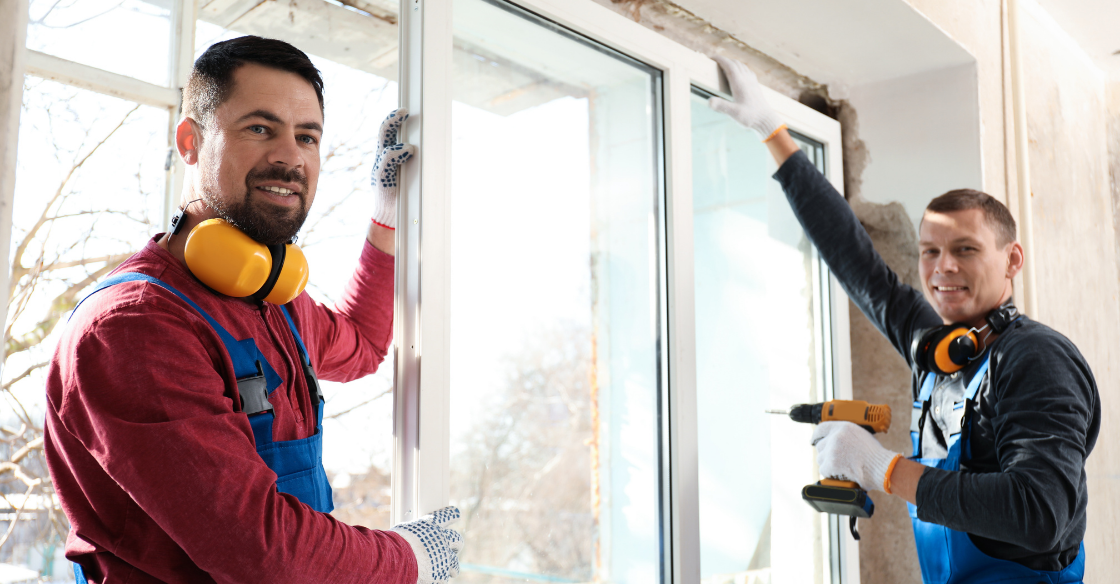 Two men installing windows
