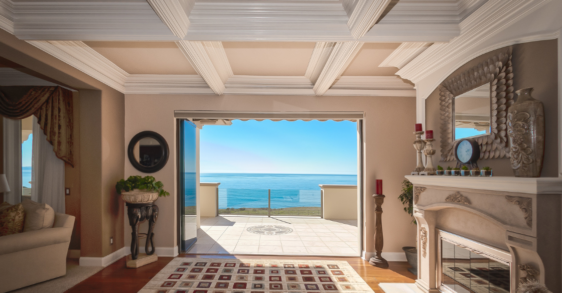 Frameless patio doors blending into traditional architecture