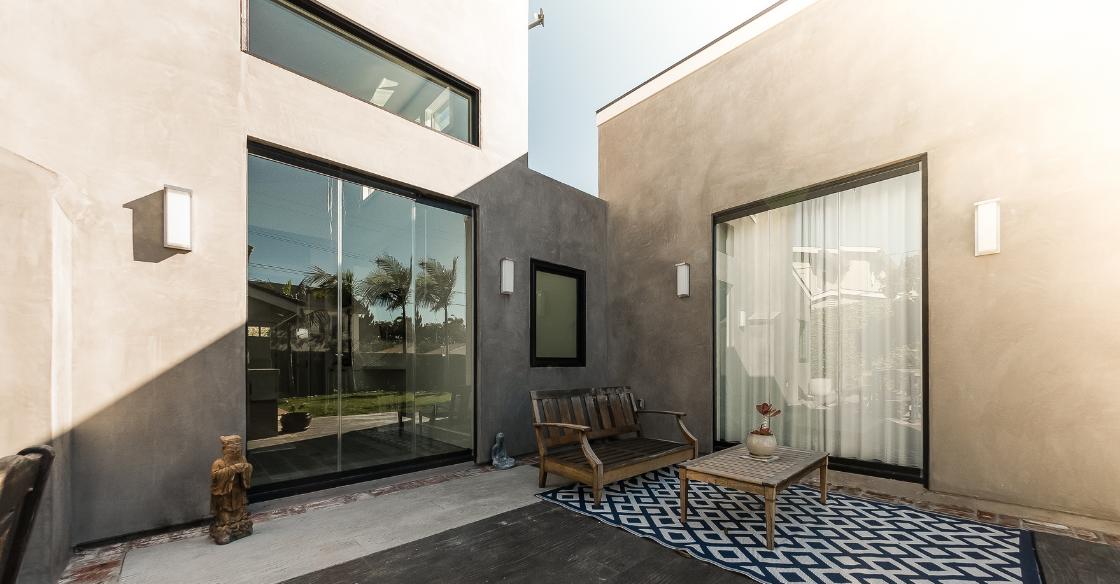 Cover Glass frameless glass doors enhancing the design of the house