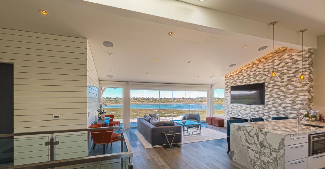 frameless glass windows bringing natural light into a home