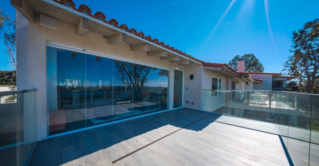 Patio with frameless glass doors